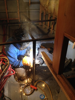 Welding the bed frame.